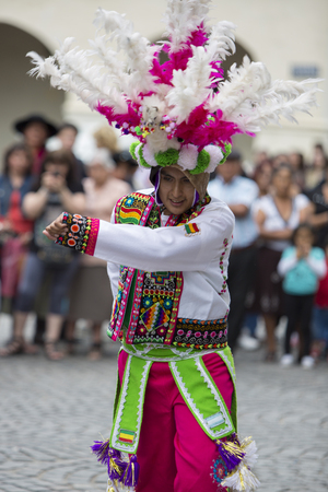 south american ethnicity: SALTA, ARGENTINA, DEC 18: Man performer dancing and celebrating the opening of the carnival of Salta in the street with colorful costume. North of Argentina 2014.