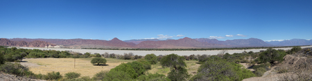ruta: Incredible panorama of the Andean colored mountains near Cachi with a clear blue sky. Ruta 40 within the Calchaqui Valleys in Salta Province. Argentina