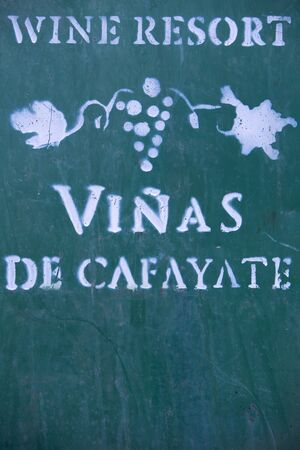 wine industry: Old green rusted metal background with signs and words depicting the wine industry in Cafayate. Argentina