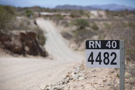 ruta: Distance Sign road on gravel road on the famous Ruta 40 (Route 40) within Calchaqui Valleys in Salta Province. Argentina