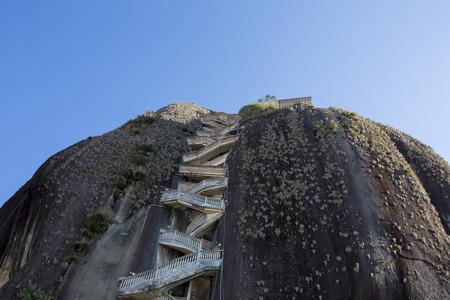 medellin: Steep steps rising up Piedra el Penol with blue clear sky, near Medellin, Colombia 2015