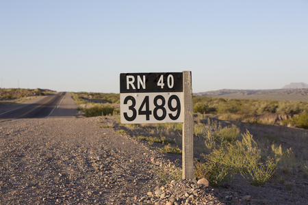 ruta: Distance Sign road on paved road on the famous Ruta 40 (Route 40) near the town of San Juan. Argentina Stock Photo