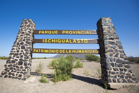 ruta: Main gate sign to the Ischigualasto National Park along the famous ruta 40 (route 40) and a clear blue sky, UNESCO Heritage World Site. San Juan Province, Argentina