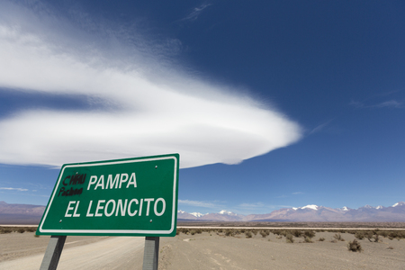aconcagua: Pampa El Leoncito wooden sign board with the view on the Aconcagua mountain, clear blue sky and the flat pan. El Leoncito National Park is a protected area in San Juan Province