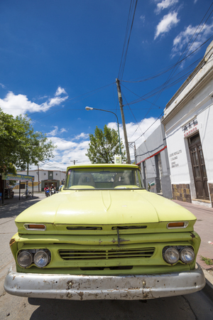 chevrolet: SALTA, ARGENTINA, DECEMBER19: Vintage green Chevrolet in the street of Salta with a clear blue sky, Argentina 2014 Editorial