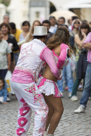 south american ethnicity: SALTA, ARGENTINA, DEC 18: Young performers dancing and celebrating the opening of the carnival of Salta in the street with colorful costumes. North of Argentina 2014