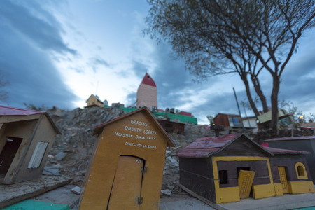 spanish houses: VALECITO, ARGENTINA, DEC 15: The Outdoors view of the Deceased Correa in Spanish Difunta Correa pilgrimage landmark in San Juan Province, with many offerings and small tiny models of wooden houses. Argentina 2014 Editorial