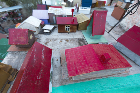deceased: VALECITO, ARGENTINA, DEC 15: The Outdoors view of the Deceased Correa in Spanish Difunta Correa pilgrimage landmark in San Juan Province, with many offerings and small tiny models of wooden houses. Argentina 2014 Editorial