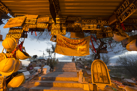 deceased: VALECITO, ARGENTINA, DEC 15: The Deceased Correa in Spanish Difunta Correa pilgrimage landmark in San Juan Province, with many offerings and registration plates from all over the world. Argentina 2014
