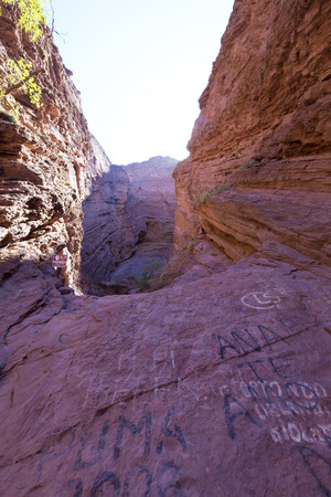 geological formation: CAFAYATE, ARGENTINA, DEC 26: Geological rock formation, Devils Throat (Garganta del Diablo) area on Quebrada de las Conchas near Cafayate city in Salta Province with a wooden sign displaying site information. Argentina. 2014
