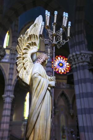 corazon: Details of religious sculpture inside the colored interior of the Capuchins Church (Iglesia del Asacrado Corazon) in the center of Cordoba. Argentina