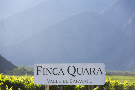 winemaker: CAFAYATE, ARGENTINA, DEC 24: Wooden welcome sign to the winemaker Finca Quara with vineyards and mountains in the background located in Cafayate, in Salta province. Argentina. 2014 Editorial