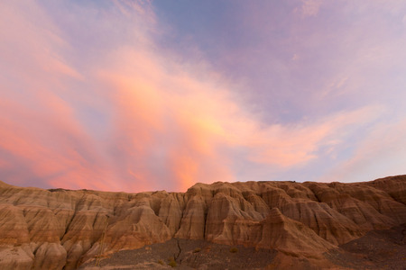 geological formation: Pink and red colored sunset with geological rock formation at Rodeo near the Lake of Wind (Dique del Viento) in San Juan Province, Argentina