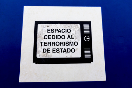 dictatorship: BUENOS AIRES, ARGENTINA, NOVEMBER 20: Blue and white sign saying in Spanish: given space to state terrorism. Parque de la Memoria is a memorial monument to the victims of the military dictatorship. Argentina 2014