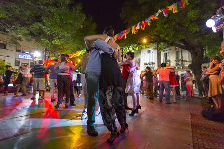 Group of people dancing the tango at night on the main square of San Telmo in Buenos Aires, Argentina 2014 Editorial