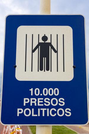 dictatorship: Blue and white sign depicting the political status During The military dictatorship in Spanish Saying: 10000 Political Prisoners. Parque de la Memoria in Buenos Aires, Argentina 2015 Memory Park