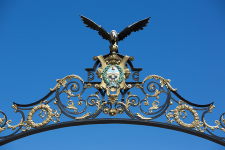 ironwork: Details of eagle ironwork on entrance gate to avenue Libertador against a clear blue sky. Mendoza. Argentina Stock Photo