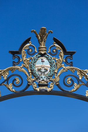 ironwork: Details of the classic ironwork on entrance gate to avenue Libertador against a clear blue sky. Mendoza. Argentina Stock Photo