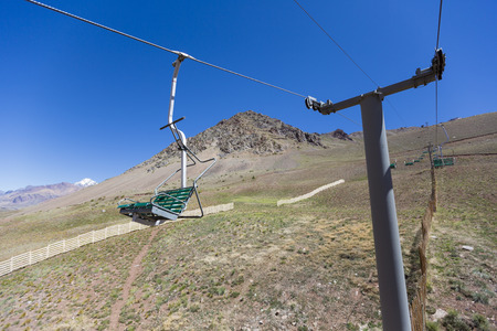aconcagua: Running empty ski lifts at Penitentes in the Aconcagua National Park during the summer with Andean mountain in the background, Argentina