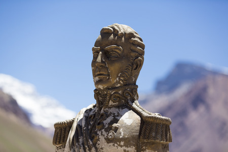 liberate: Statue of General San Martin with the Aconcagua peak and clear blue sky at the Aconcagua National Park. Landmark near Mendoza, Argentina (Selective focus) Editorial