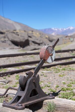ruta: Details of old abandoned train station and railroad tracks along ruta 7 in the Andean Mountains at the border with Argentina and Chile. (Selective focus)