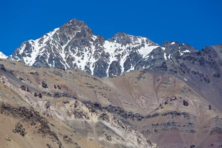 aconcagua: Details of the Aconcagua mountain peak with clear blue sky at the Aconcagua National Park. Landmark near Mendoza, Argentina