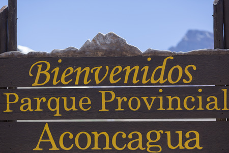 aconcagua: Welcome wooden sign at the Aconcagua National Park with clear blue sky, Andes Mountains, Argentina