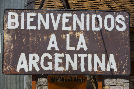 aconcagua: Rusted old retro sign saying welcome to Argentina written in Spanish at old train station at the border of Chile and Argentina near the Aconcagua National Park. Argentina
