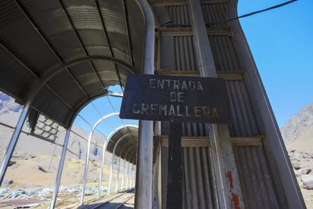 ruta: Old abandoned train station and railroad tracks along ruta 7 in the Andean Mountains at the border with Argentina and Chile. Stock Photo