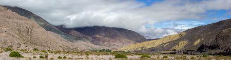 siete: Panorama of Cerro del los Siete Colores (Hill of Seven Colors) over Purmamarca village (Quebrada de Humahuaca valley), Argentina