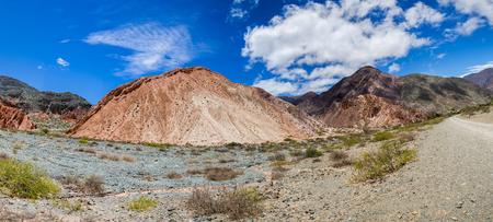 colores: Panorama of Cerro del los Siete Colores (Hill of Seven Colors) over Purmamarca village (Quebrada de Humahuaca valley), Argentina