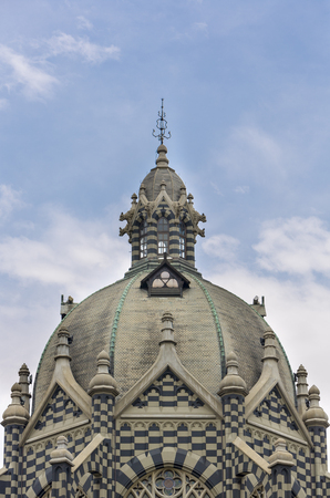 medellin: Details of roof from classical church in Medellin with cloudy blue sky. Colombia 2015