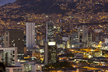 Aerial view of Medellin at night with residential and office buildings. Colombia 2015