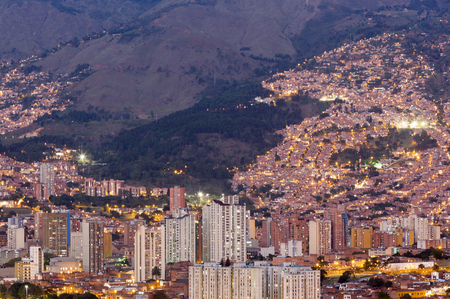 Aerial view of Medellin at night with residential and office buildings. Colombia Фото со стока