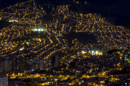 antioquia: Aerial view of Medellin at night with residential and office buildings. Colombia Stock Photo