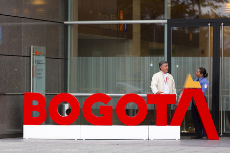 security staff: Big letters Saying Bogota and security staff of official building in the business district of Bogota. Colombia 2015 Editorial