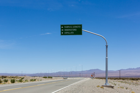 ruta: Directional road sign and blue sky at Pampa El Leoncito along the ruta 40 (Route 40) in San Juan Province. Argentina Stock Photo