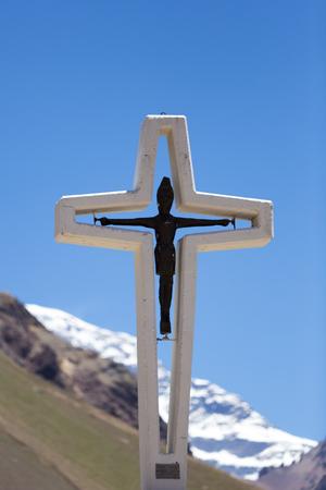 aconcagua: Religious cross with  the peak of the Aconcagua with clear blue skyn Landmark near Mendoza, Argentina