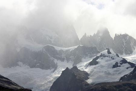 chalten: Closeup of Fitzroy mountain and snow peak in El Chalten with clouds. Argentina