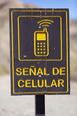 ruta: Direction road with sign cellular mobile phone signal road at El Alcazar pass on ruta 40 (Route 40), San Juan Province. Argentina