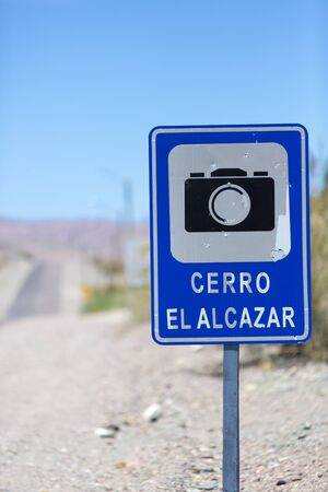ruta: Photo road with sign pole and blue sky at the El Alcazar pass along the ruta 40 (Route 40) in San Juan Province. Argentina Stock Photo