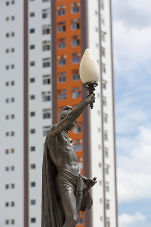 amazonas: Classic old statue and street light with modern building in the background. Details of the opera of Manaus. Amazonas State. Brazil (Selective focus)
