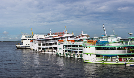 amazonas: Typical white wooden passengers Amazon boats in the harbor of Manaus, Amazonas State. Brazil 2015