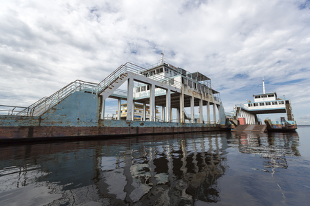 steps and staircases: Wide angle view of three barges with water reflections anchored at the harbor of Manaus. Amazon State. Brazil 2015 Editorial