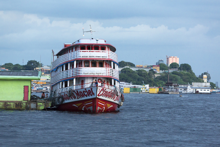 amazonas: Typical red and white wooden passengers Amazon boat in the harbor of Manaus, Amazonas State. Brazil 2015 Editorial