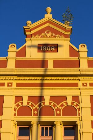 amazonas: Details of the old colonial market facade build in 1906 in Manaus with sunset light ad clear blue sky. Amazonas State, Brazil