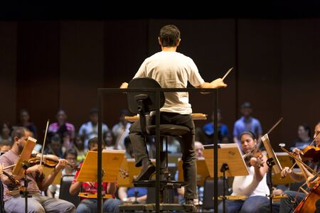 amazonas: Orchestra conductor at work with music school students repeating daily Their music session at the Amazon Theatre. Manaus, Amazonas Brazil 2015