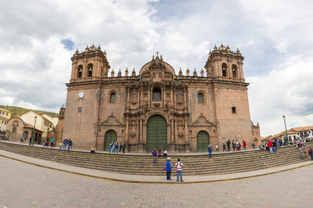 Panorama of the historic Iglesia de la Compania in Cusco with group of tourists. Peru. The church dates back to 1571 and sits on top of an old Inca Palace. Peru 2015
