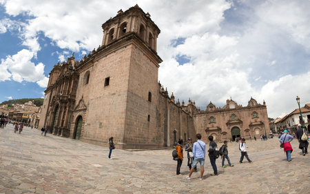 Panorama of the historic Iglesia de la Compania in Cusco with group of Japanese tourists. Peru. The church dates back to 1571 and sits on top of an old Inca Palace. Peru 2015
