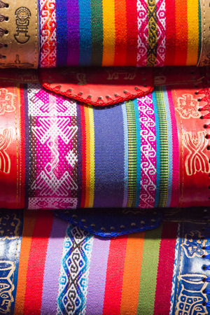 artisanry: Handmade colored woolen bags for sale at the tourist craft market in Cusco. Peru